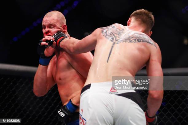 Alexander Volkov of Russia hits Stefan Struve of the Netherlands as they compete in their Heavyweight bout during the UFC Fight Night at Ahoy on...