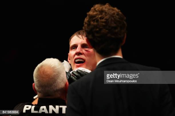Alexander Volkov of Russia is attended to by the medical staff as he celebrates victory against Stefan Struve of the Netherlands in their Heavyweight...