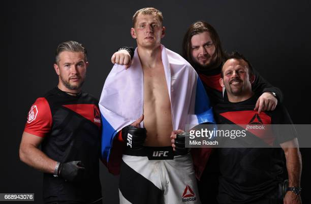 Alexander Volkov of Russia poses for a post fight portrait backstage with his team during the UFC Fight Night event at Sprint Center on April 15 2017...