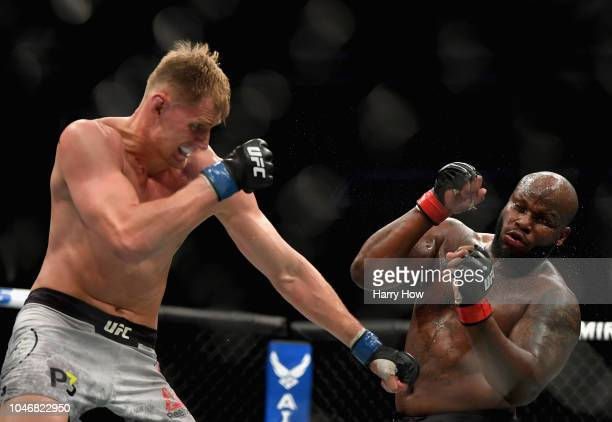 Alexander Volkov of Russia punches Derrick Lewis in their heavyweight bout during the UFC 229 event inside TMobile Arena on October 6 2018 in Las...