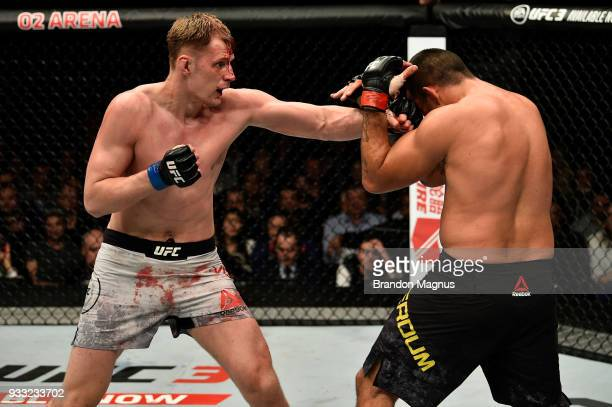 Alexander Volkov of Russia punches Fabricio Werdum of Brazil in their heavyweight bout inside The O2 Arena on March 17 2018 in London England