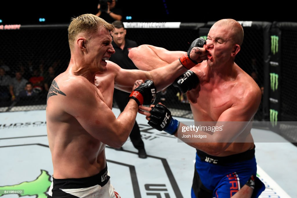 Alexander Volkov of Russia punches Stefan Struve of The Netherlands in their heavyweight bout during the UFC Fight Night event at the Rotterdam Ahoy on September 2, 2017 in Rotterdam, Netherlands.