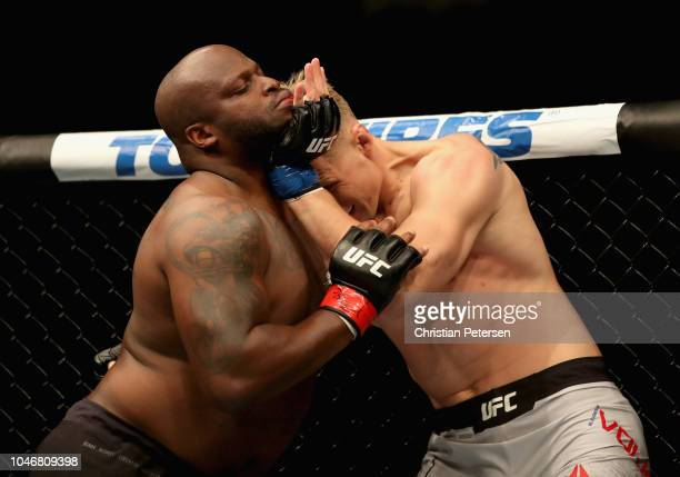 Alexander Volkov of Russia pushes the face of Derrick Lewis in their heavyweight bout during the UFC 229 event inside TMobile Arena on October 6 2018...