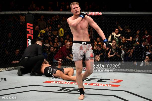 Alexander Volkov of Russia reacts after defeating Fabricio Werdum of Brazil in their heavyweight bout inside The O2 Arena on March 17 2018 in London...