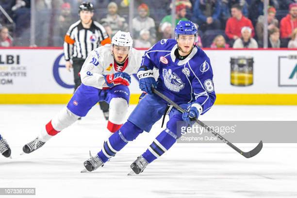 Alexander Volkov of the Syracuse Crunch and Jake Evans of the Laval Rocket skating up the ice to join the play at Place Bell on December 14 2018 in...