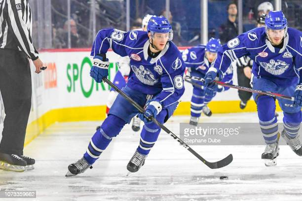 Alexander Volkov of the Syracuse Crunch in control of the puck against the Laval Rocket at Place Bell on December 14 2018 in Laval Quebec