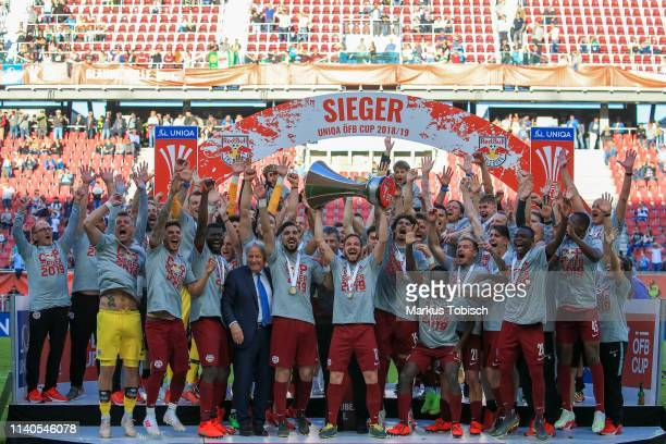 Alexander Walke Jerome Onguene Munas Dabbur Andreas Ulmer and Andre Ramalho Silva of RB Salzburg celebrate with the trophy during the OeFB Cup Final...