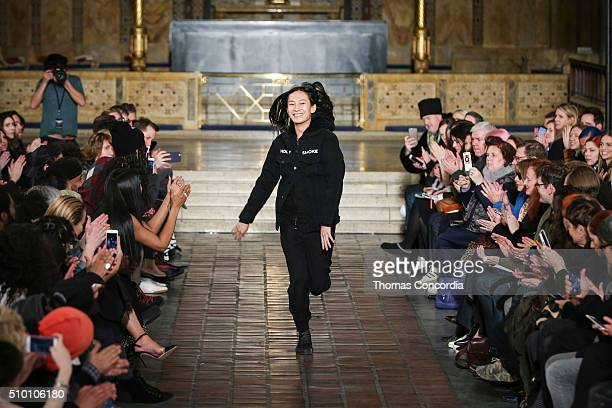 Alexander Wang greets the audience after presenting his Fall 2016 Collection at St Bartholomew's Church on February 13 2016 in New York City