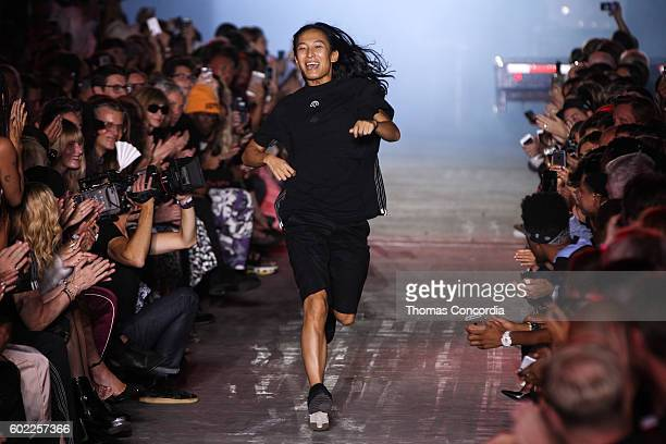 Alexander Wang greets the audience after presenting his Spring 2017 collection at The Arc Skylight at Moynihan Station during New York Fashion Week...