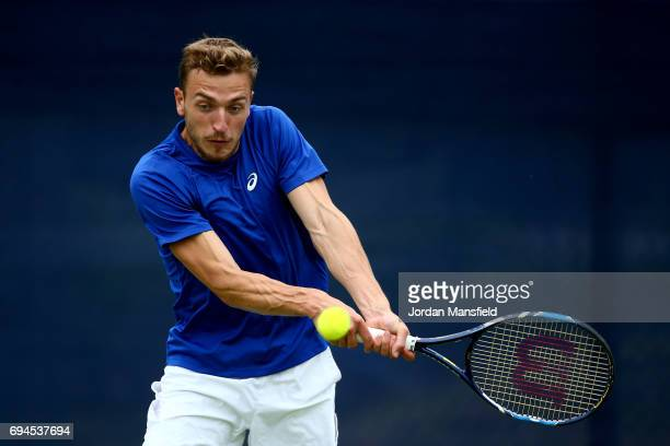 Alexander Ward of Great Britain plays a forehand during his match against Tim Puetz of Germany during day one of Qualifying of the Aegon Open at...