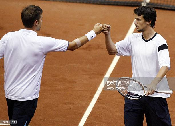 Alexander Waske and Philipp Petzscher of Germany celebrate their victory over Dmitry Tursunov and Mikhail Youzhny of Russia during the second day of...