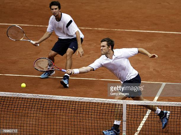 Alexander Waske and Philipp Petzscher of Germany returns a ball to Dmitry Tursunov and Mikhail Youzhny of Russia during the second day of the Tennis...