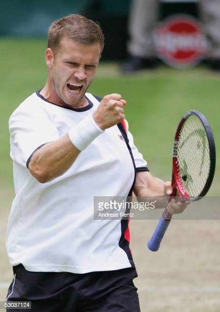 Alexander Waske of Germany celebrates after beating Rafael Nadal of Spain in three sets during the Gerry Weber Open on June 8 2005 in Halle Germany