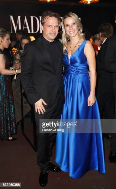 Alexander Weih and Miss Bambi Laura pose at the Bambi Awards 2017 party at Atrium Tower on November 16 2017 in Berlin Germany