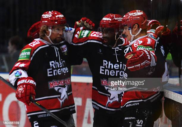 Alexander Weiss of Koeln celebrates with team mates after scoring his teams first goal during the DEL match between Koelner Haie and Thomas Sabo Ice...