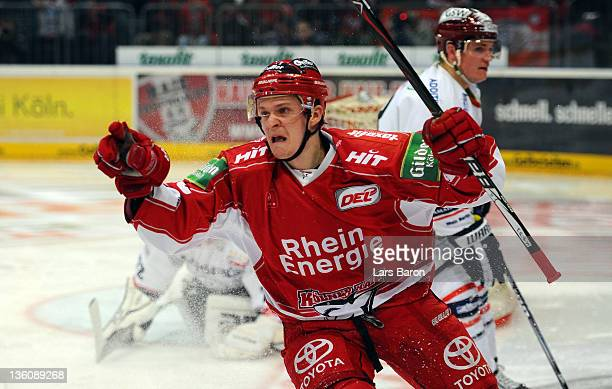 Alexander Weissof Koeln celebrates after scoring his teams first goal during the DEL match between Koelner Haie and Eisbaeren Berlin at Lanxess Arena...