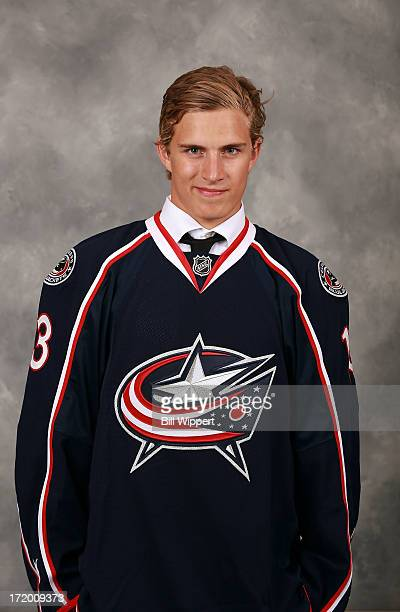 Alexander Wennberg 14th overall pick by the Columbus Blue Jackets poses for a portrait during the 2013 NHL Draft at Prudential Center on June 30 2013...