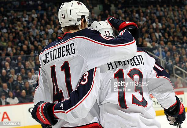 Alexander Wennberg and Cam Atkinson of the Columbus Blue Jackets celebrate a third period goal against the Winnipeg Jets at the MTS Centre on...