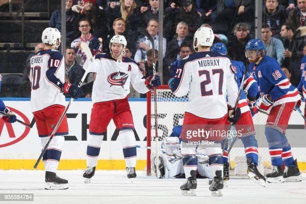 Alexander Wennberg Boone Jenner and Ryan Murray of the Columbus Blue Jackets celebrate after scoring a goal in the first period against Henrik...