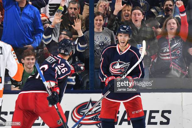 Alexander Wennberg of the Columbus Blue Jackets celebrates his second period goal with teammate Kyle Quincey of the Columbus Blue Jackets during a...