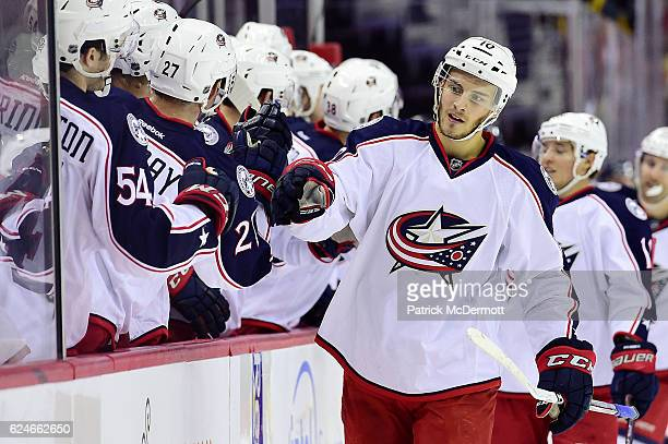 Alexander Wennberg of the Columbus Blue Jackets celebrates his third period goal with his teammates during a NHL game against the Washington Capitals...