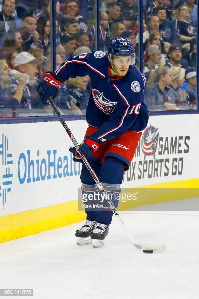 Alexander Wennberg of the Columbus Blue Jackets controls the puck during the game against the New York Islanders on October 6 2017 at Nationwide...