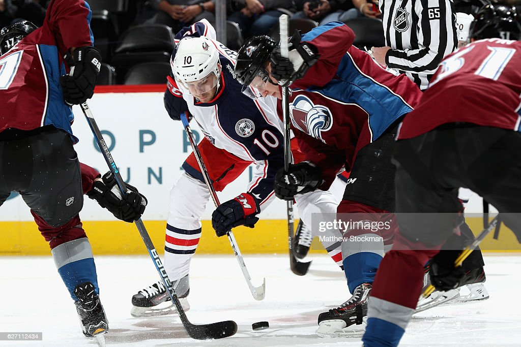 Alexander Wennberg #10 of the Columbus Blue Jackets faces off against Nathan MacKinnon #29 of the Colorado Avalanche at the Pepsi Center on December 1, 2016 in Denver, Colorado.