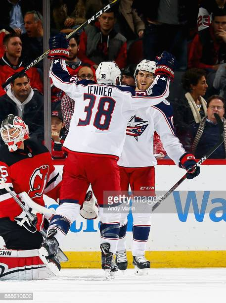 Alexander Wennberg of the Columbus Blue Jackets is congratulated by Boone Jenner after scoring the game winning goal against the New Jersey Devils...