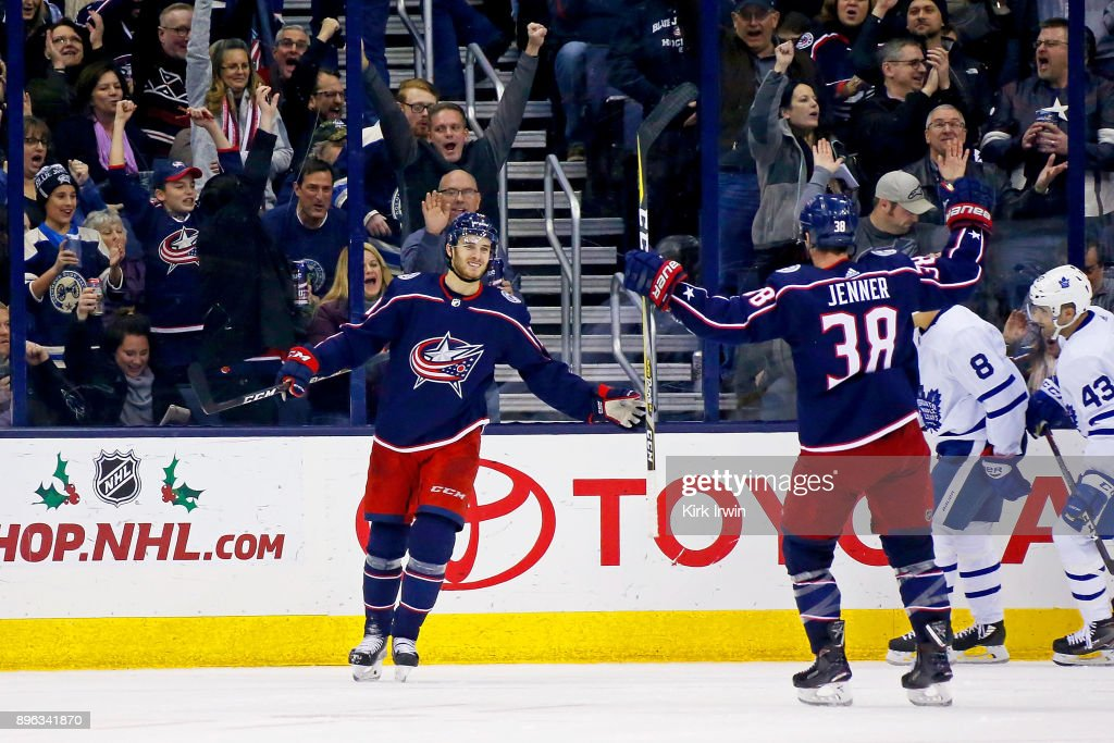 Alexander Wennberg #10 of the Columbus Blue Jackets is congratulated by Boone Jenner #38 of the Columbus Blue Jackets after scoring a goal during the third period of the game against the Toronto Maple Leafs on December 20, 2017 at Nationwide Arena in Columbus, Ohio. Columbus defeated Toronto 4-2.