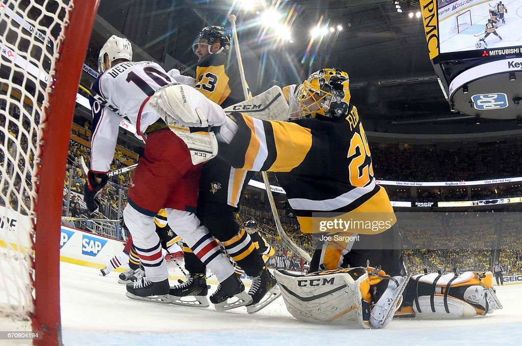 Alexander Wennberg #10 of the Columbus Blue Jackets knocks over Marc-Andre Fleury #29 of the Pittsburgh Penguins resulting in a goaltender interference penalty in Game Five of the Eastern Conference First Round during the 2017 NHL Stanley Cup Playoffs at PPG Paints Arena on April 20, 2017 in Pittsburgh, Pennsylvania.