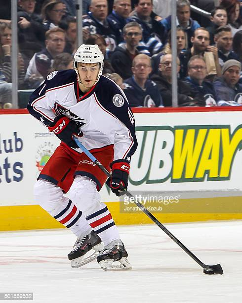 Alexander Wennberg of the Columbus Blue Jackets plays the puck down the ice during first period action against the Winnipeg Jets at the MTS Centre on...