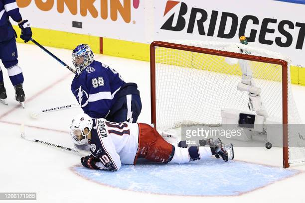 Alexander Wennberg of the Columbus Blue Jackets scores a goal past Andrei Vasilevskiy of the Tampa Bay Lightning during the third period in Game Two...