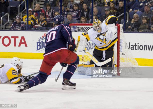 Alexander Wennberg of the Columbus Blue Jackets scores on Tristan Jarry of the Pittsburgh Penguins during third period of the game between the...