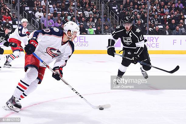 Alexander Wennberg of the Columbus Blue Jackets skates with the puck against Anze Kopitar of the Los Angeles Kings on October 25 2016 at Staples...
