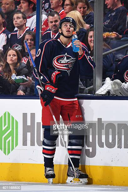 Alexander Wennberg of the Columbus Blue Jackets watches the replay after losing his tooth to a high stick during the second period of a game against...