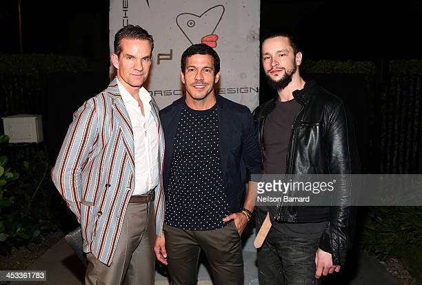 Alexander Werz Dan Ragone and Luis Monteagudo attend the Porsche Design x Thierry Noir Art Basel Miami Beach Event at The Temple House on December 3...