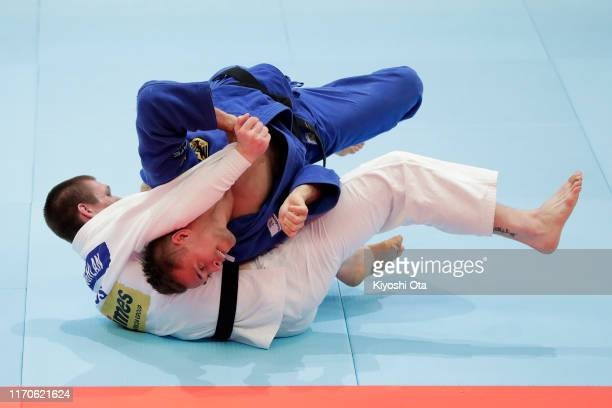 Alexander Wieczerzak of Germany and Eoin Coughlan of Australia compete in the Men's 81kg Pool C second round on day four of the World Judo...