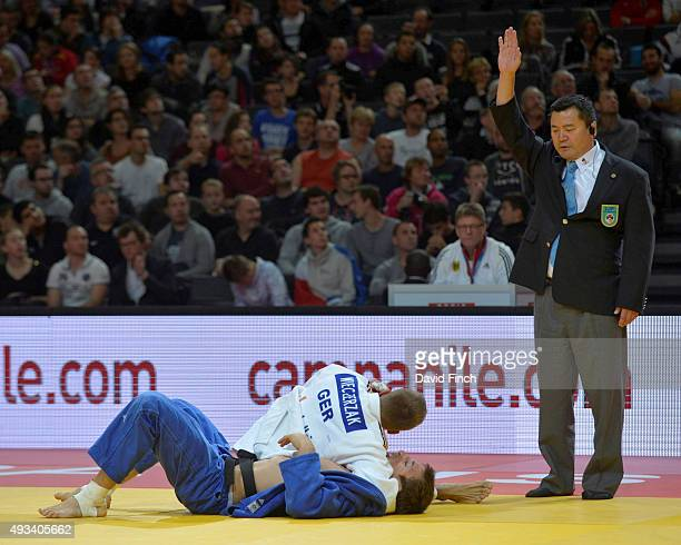 Alexander Wieczerzak of Germany holds Marcel Ott of Austria for an ippon to win their u81kg contest during the 2015 Paris Grand Slam on Sunday at the...