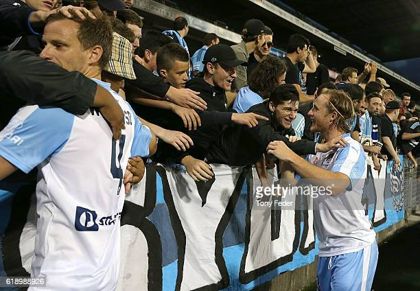 Alexander Wilkinson and Rhyan Grant of Sydney FC celebrate with fans after beating the Jets during the round four ALeague match between the Newcastle...