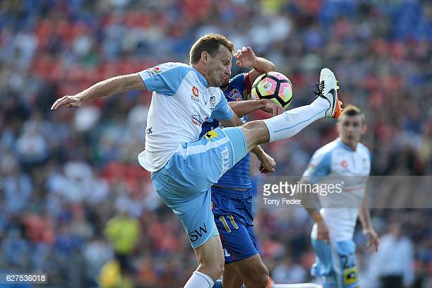 Alexander Wilkinson of Sydney Fc contests the ball with Labinot Haliti of the Jets during the round nine ALeague match between the Newcastle Jets and...