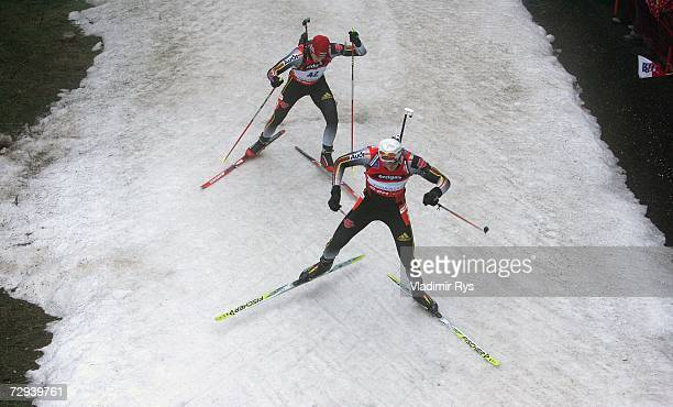 Alexander Wolf and his team mate Daniel Graf of Germany compete during the 10km Men's Sprint competition of the EON Ruhrgas IBU Biathlon World Cup on...