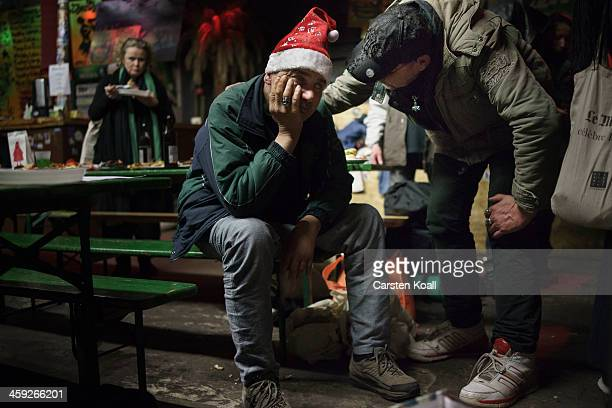 Alexander Wuellmann who has been homeless for the last 4 years speaks to Kersten Dallof who has been homeless for the last 25 years during the...