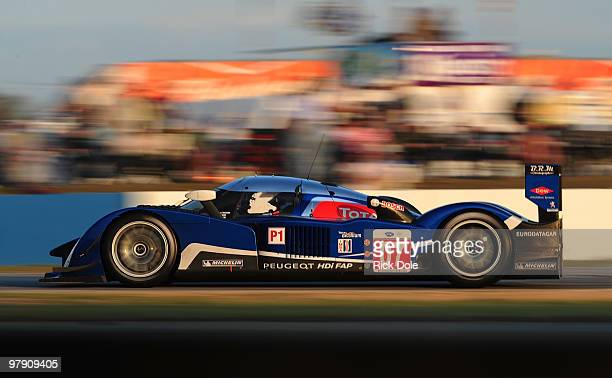 Alexander Wurz, Anthony Davidson, and Marc Gene drive the Team Peugeot Total Peugeot 908 to victory in the ALMS 12 Hours of Sebring at Sebring...