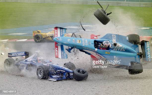 Alexander Wurz of Austria driving the Mild Seven Benetton Playlife Benetton B198 Playlife V10 overturns in the gravel trap during a crash with Jarno...