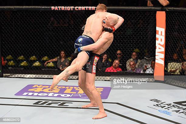Alexander Yakovlev attempts a takedown against Gray Maynard in their lightweight fight during the UFC Fight Night event at the Patriot Center on...