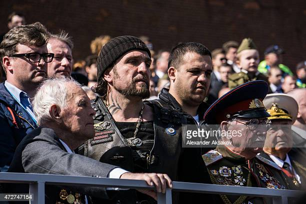 Alexander Zaldostanov aka Surgeon sits next to veterans at the Victory Parade which is part of celebrations marking the 70th anniversary of the...