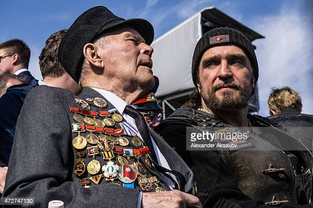 Alexander Zaldostanov aka Surgeon talks to a veteran attends the Victory Parade which is part of celebrations marking the 70th anniversary of the...