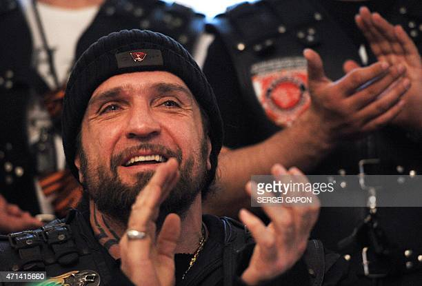 Alexander Zaldostanov also known as 'Khirurg' leader of the Night Wolves bikers' club applauds as he talks to media in Brest on April 28 2015 Ten...