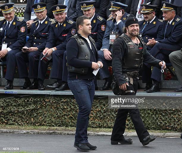 Alexander Zaldostanov also known as Khirurg leader of the Russian biker group Nochniye Volki attends a military parade October 16 2014 in Belgrade...