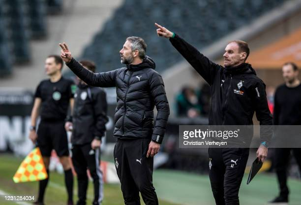 Alexander Zickler and Head Coach Marco Rose of Borussia Moenchengladbach are seen during the Bundesliga match between Borussia Moenchengladbach and...